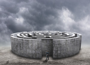 3D circular labyrinth against cloudy sky
